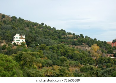 Countryside, hill with a few solitary houses surrounded by greenery