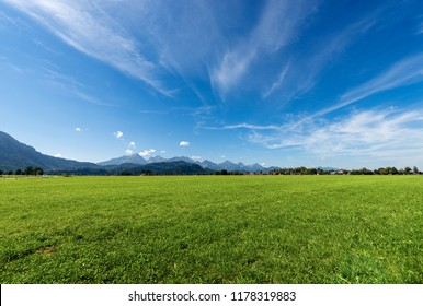 Countryside Landscape with a green meadow and Alps near Schwangau, Fussen, Bavaria, Germany