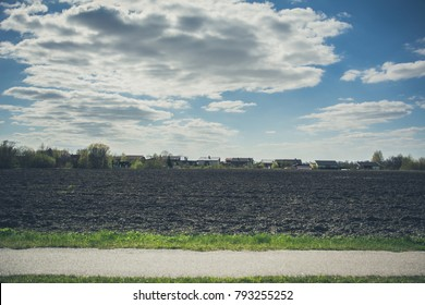 Countryside landscape of ploughed field in spring, in Lithuania. Vintage affect.