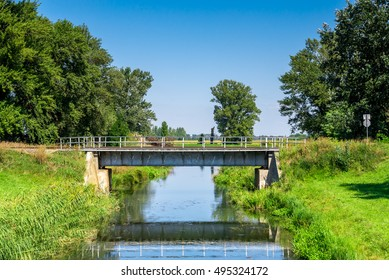 Countryside landscape railroad steel bridge over water canal