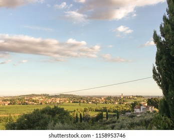 Countryside landscape, Vineyards in Valpolicella, Province of Verona, northern Italy, Italy. Landscape with clouds and vineyards,  Valpolicella wine region. View  the village of San Pietro Incariano