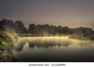 countryside morning sunrise river mist scenery landscape  wit htranquil foggy water mirror and dark dramatic moody sky