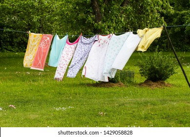 Countryside outdoor park view of drying clothes in a wind.