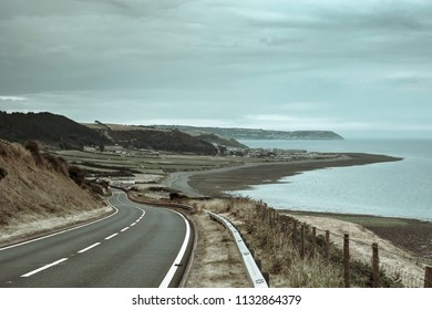 Countryside road with amazing  views on Pembrokeshire coastline,South Wales, Uk in summer.Scenic landscape of british coast.Road with sea view in coastal area of Great Britain.Travel photography.