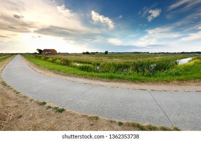 countryside road in dutch farmland, Holland