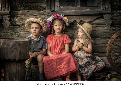 Countryside rustic lifestyle children sitting together old countryside house  symbolizing kids friendship and happy carefree rustic childhood