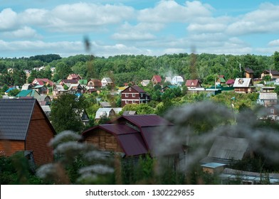 Countryside summerhouses (dachas), traditional Russian dachas. View of country village in suburbs, rural landscape