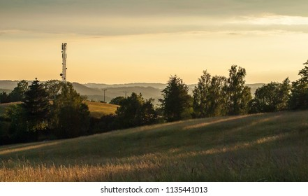 Countryside, sunset and signal tower