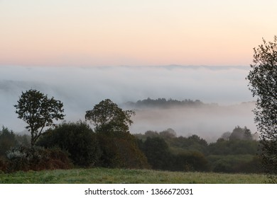 Countryside under the fog at sunrise in Brittany
