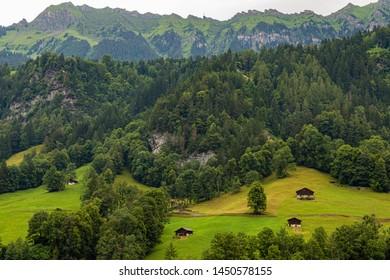Countryside view and farmland of Lauterbrunnen village in Swiss Alps, Switzerland.