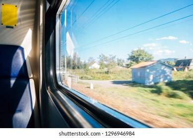 Countryside village by train window in Russia