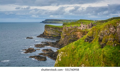 County Antrim coastline with Dunluce Castle, Northern Ireland