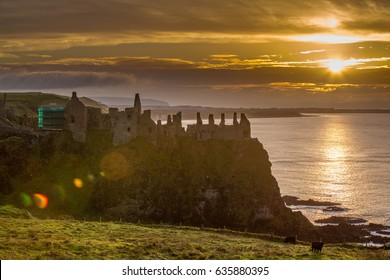 County Antrim, Northern Ireland. 24 September 2016. Sun sets behind Dunluce Castle near Bushmills, Department of Environment carries out work on the castle.