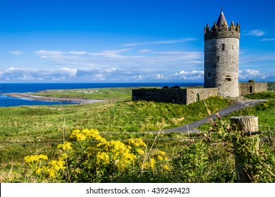 County Clare, Ireland: Round tower of Doonagore castle stands above the village of Doolin and the South Sound of Galway Bay