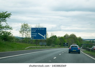 County Durham, England, Britain - 19th May 2019: Blue Motorway sign directing drivers off the A1 towards Chester le Street and Stanley in County Durham, North East. British motorway sign.