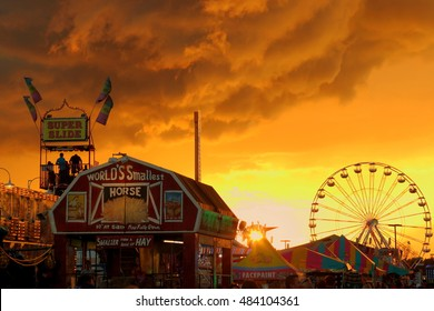 County Fair Midway At Sunset With Approaching Storm
