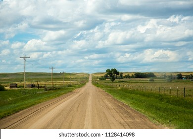 a county gravel road runs through farm land in north eastern Colorado east of Sterling