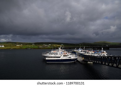 County Kerry, Ireland - 13 SEPTEMBER 2018 : Tour boats to Skellig Micheal moored at Portmagee harbour, a fishing village located in south west of Ireland.