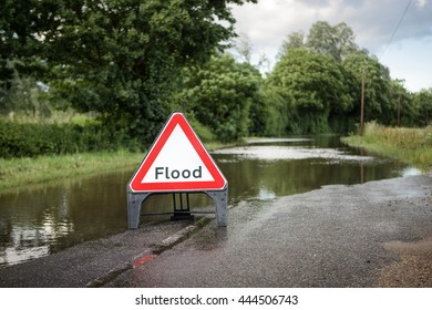 county road in essex of flooded road closed due to severe rain