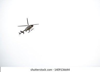 A County Sherrif Helicopter isolated on a white background.