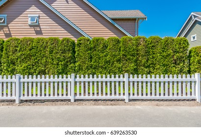 County style wooden fence separate and protect private property.