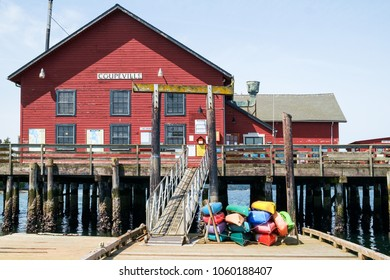 Coupeville, WA USA May 21, 2017: Rental kayaks of various colors at historic Coupeville Wharf which also houses the marina offices