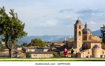 Couple admires panorama of Urbino, Italy