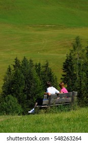 a couple admires the view in relaxation of the Dolomites in Alta Badia, Italy