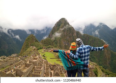 Couple admiring the spectacular view of Machu Picchu, Cusco Region, Urubamba Province, Peru, Archaeological site, UNESCO World Heritage