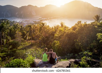A couple admiring the view at sunset on Phi Phi island in Thailand