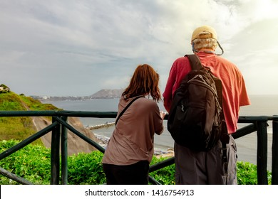 Couple of adults observe the sea from the Love Park of Miraflores district in Lima, Peru