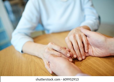 Couple of affectionate seniors holding by hands