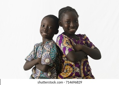 Couple of African brother and sister posing in studio, isolated