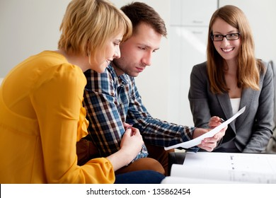 Couple analyzing contract for new home