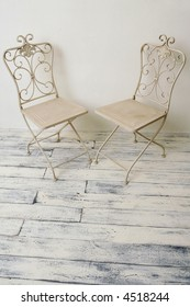 A couple of antique-like chairs.