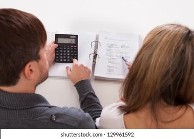 Couple argue about money especially house expenses.