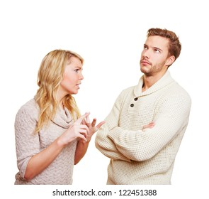 Couple argueing in over a problem with angry woman and sulking man