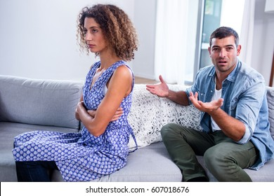 Couple arguing with each other at home