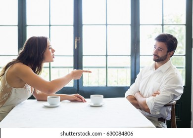 Couple arguing with each other in the restaurant