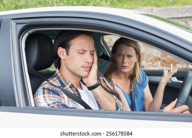 Couple arguing together in their car