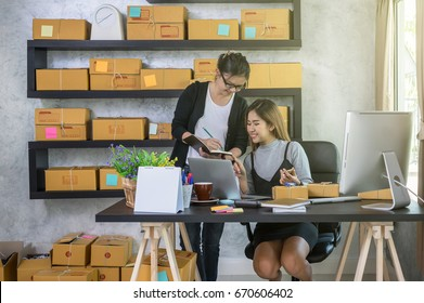 Couple asian teenager owner business people work at home for online shopping, checking the order of product in technology computer and laptop, entrepreneur and alpha generation life style concept