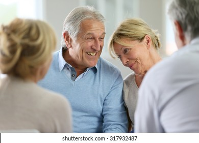 Couple attending group therapy