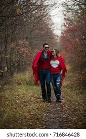 couple in the autumn forest on a walk