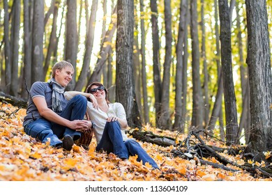 the couple in an autumn wood