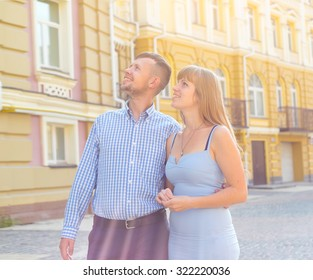 Couple backpack in city. Travel, vacation and friendship. Happy couple, attractive woman and man walking in city and enjoying romance. Love story, couple, smiling and have fun together. Kiev, Ukraine.