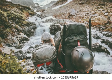 Couple backpackers hiking in mountains together love and Travel adventure Lifestyle wanderlust concept active vacations outdoor