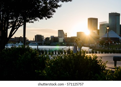 Couple in Baltimore City Inner Harbor at Sunset