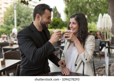 Couple in bar celebratibng anniversary and drinking beer and valentines