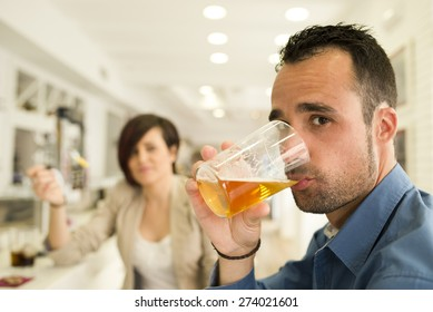 Couple in bar having date, eating and drinking with ambient window lights