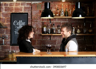 Couple at the bar with two glasses of wine